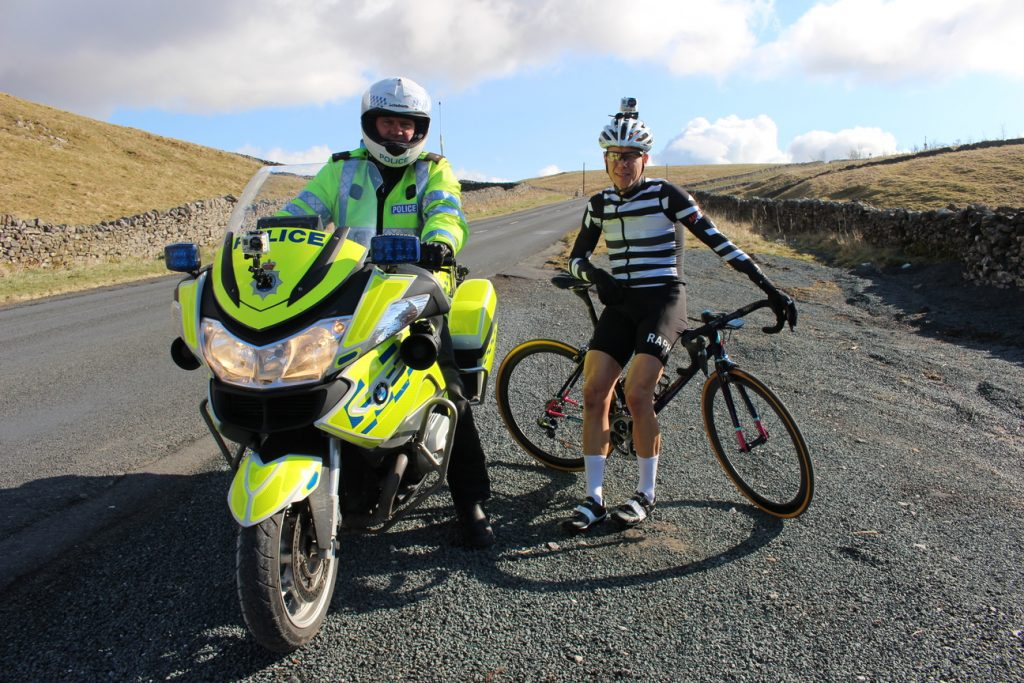 Jamie Sharp with his police escort on a beautiful North Yorkshire day